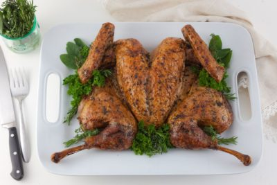 spatchcock-turkey-10-roasted-on-plate-photo-by-kelly-cline-for-allrecipes
